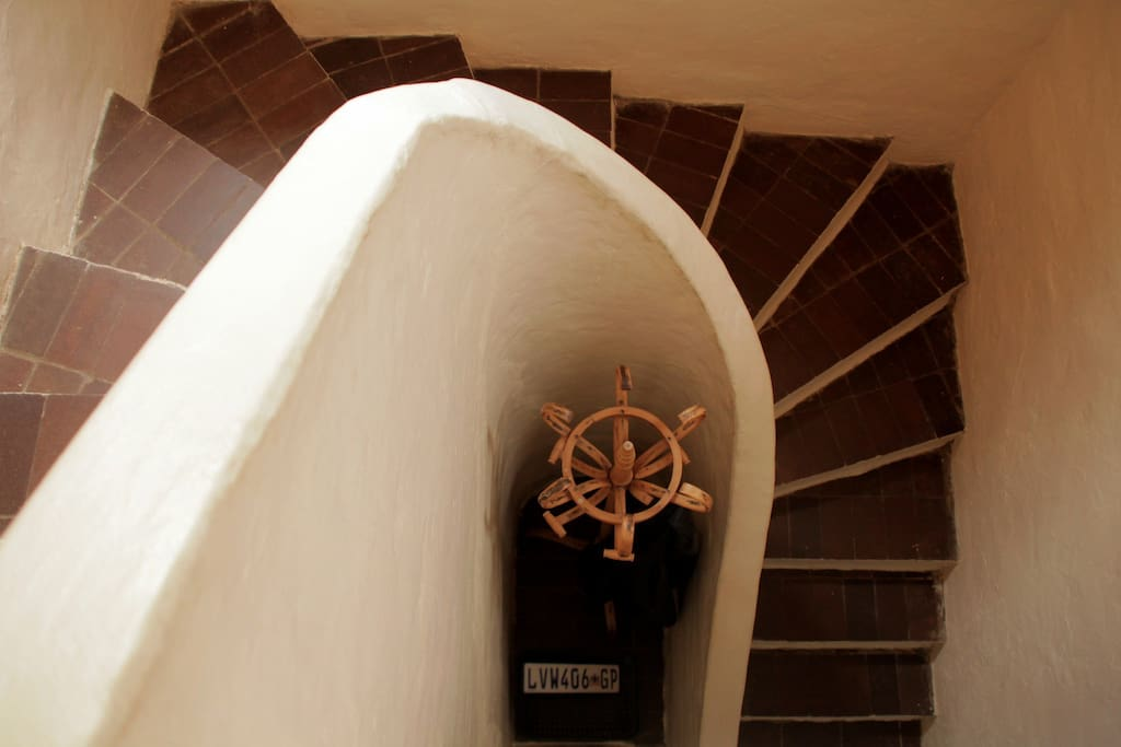 spiral starircase leading to bedrooms downstairs