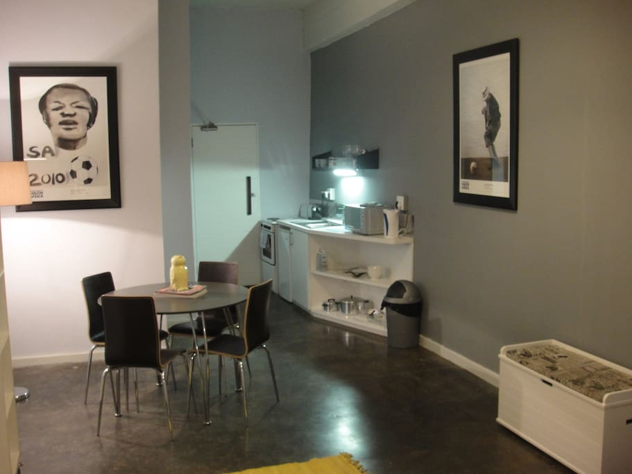 The studio has a dining area, small kitchen, queen size bed, and flat screen TV.