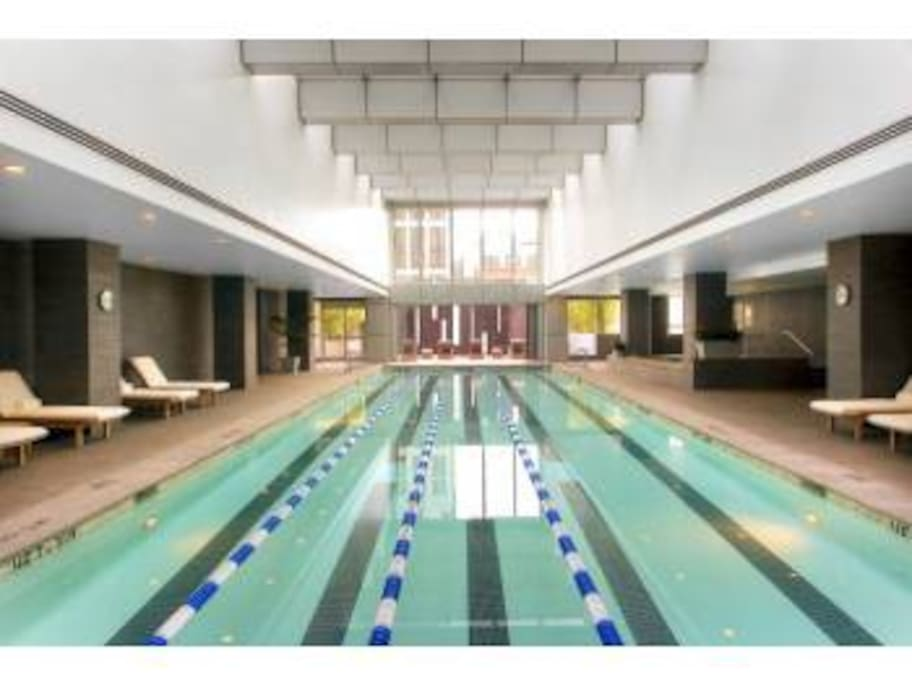 The glass ceiling gives this heated indoor lap pool an outdoor feel. There is a large jacuzzi to the right of the pool. Steam rooms are inside men's and women's locker rooms.