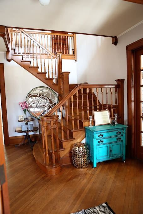 The grand stair case greets your welcome.