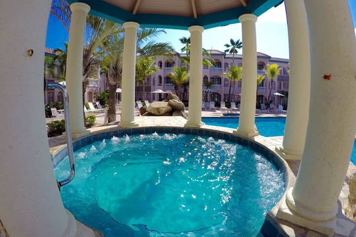 The view from the 8 person jacuzzi overlooking the back pool.