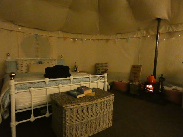 The Yurt is toasty on a cold evening with the log fire, tent insulation and the wooden platform it sits on.