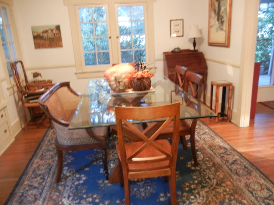 Formal dining room seats up to 8.