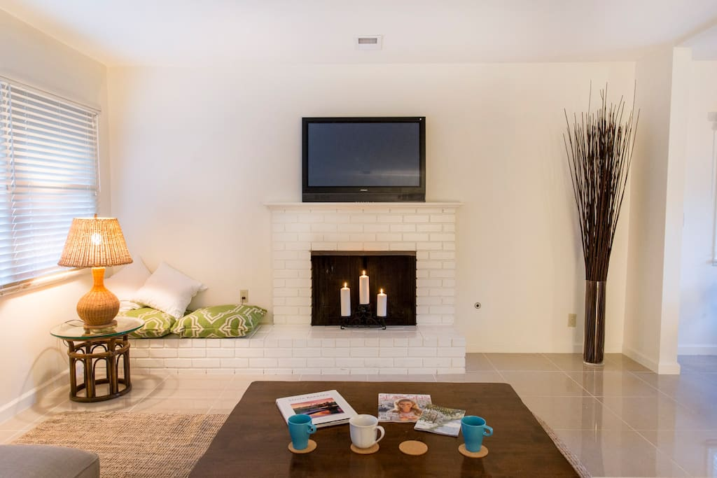 Flat screen TV with gas fireplace or candles