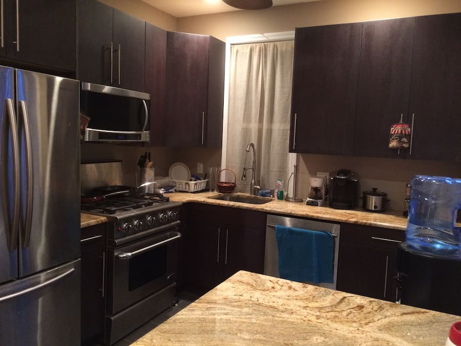 This is the kitchen which includes a full-size refrigerator, oven, dishwasher and microwave.