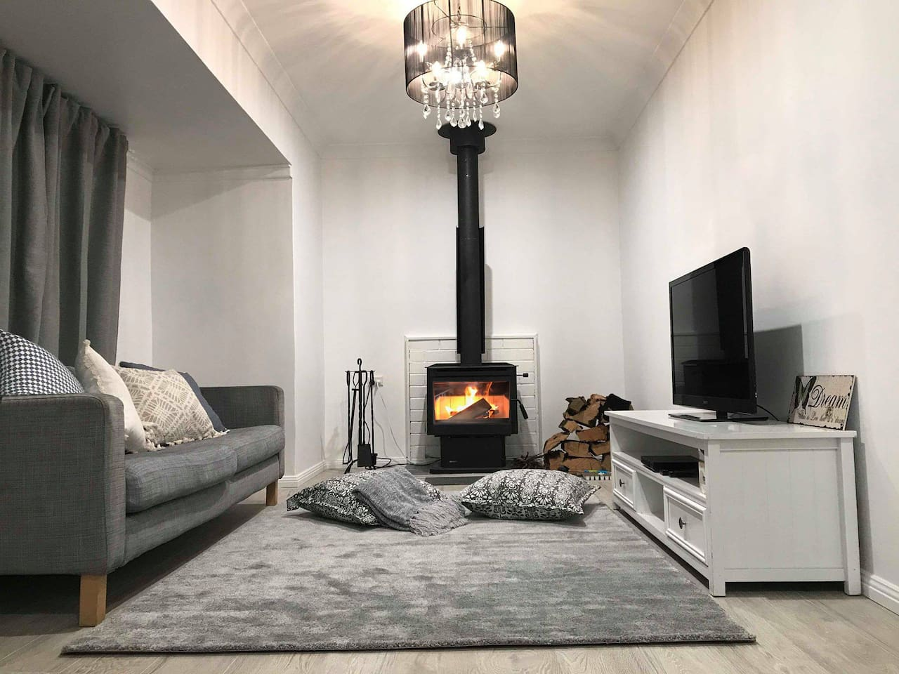 Chill out by the fireplace on our cosy cushions and rug