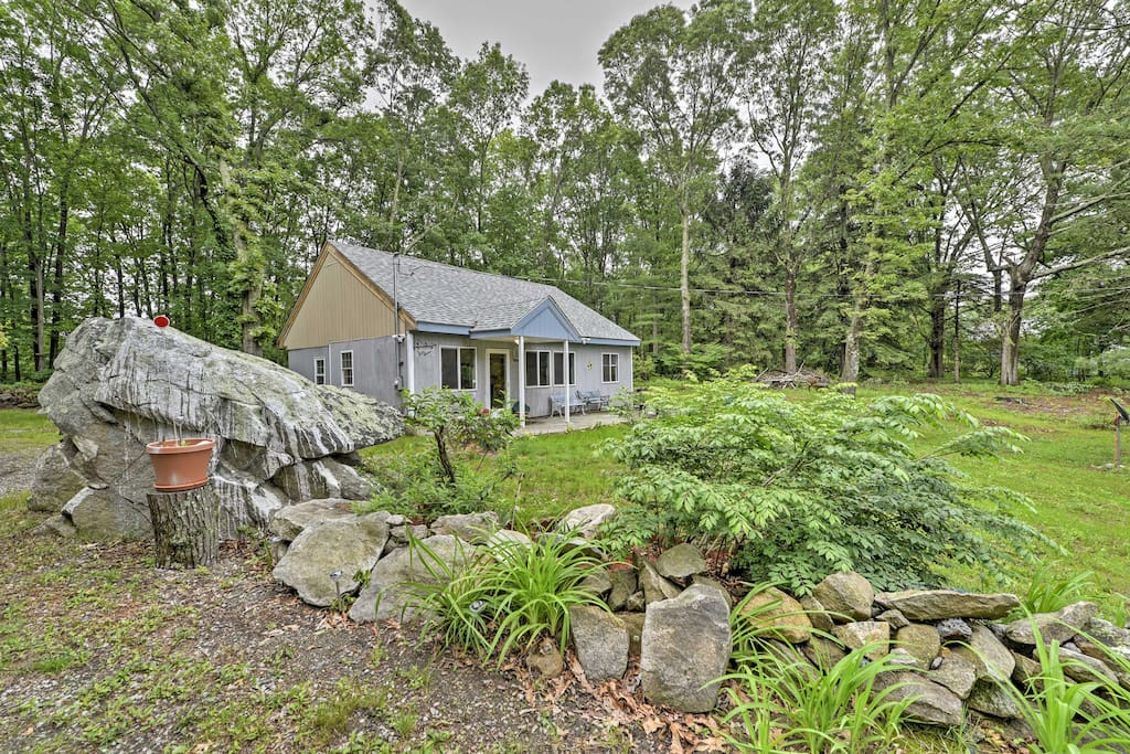 The charming cottage is situated on a half acre of land, surrounded by trees.