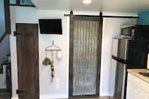 Closet, TV, Door to bathroom.  All barn wood was forged from good friend Matt Williams property.