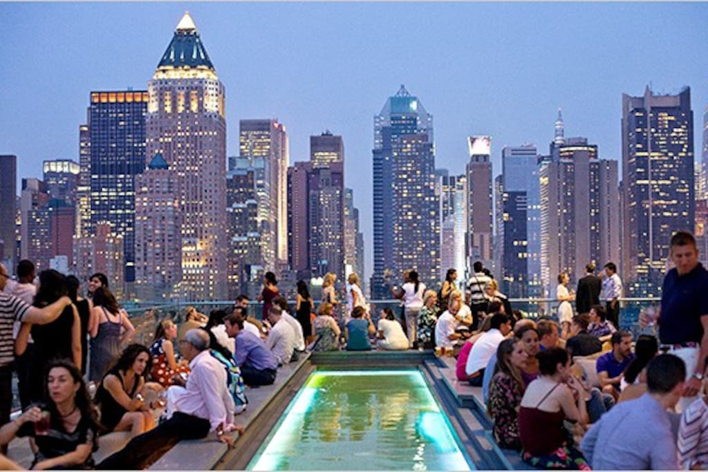 This famous rooftop bar is steps away!