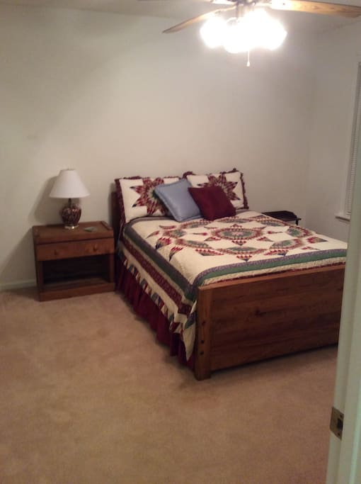 Fully furnished quaint bedroom with queen bed.