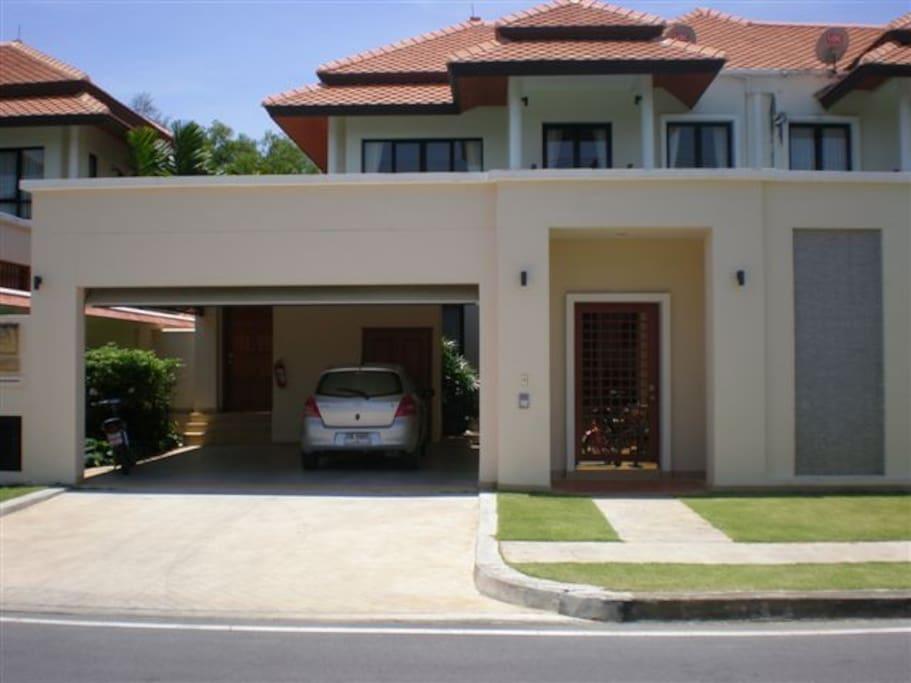 House exterior with car port