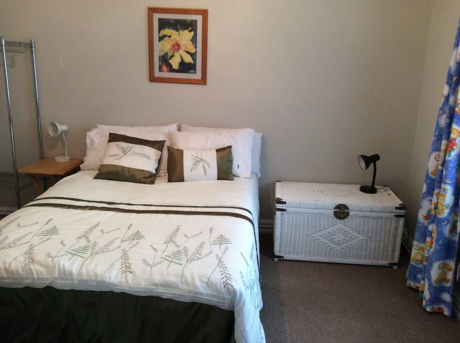 comfortable double room, white cane furniture