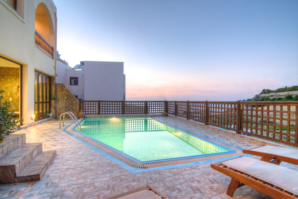 Swimming pool with sea view, sun beds, umbrellas and pool alarm for child safety