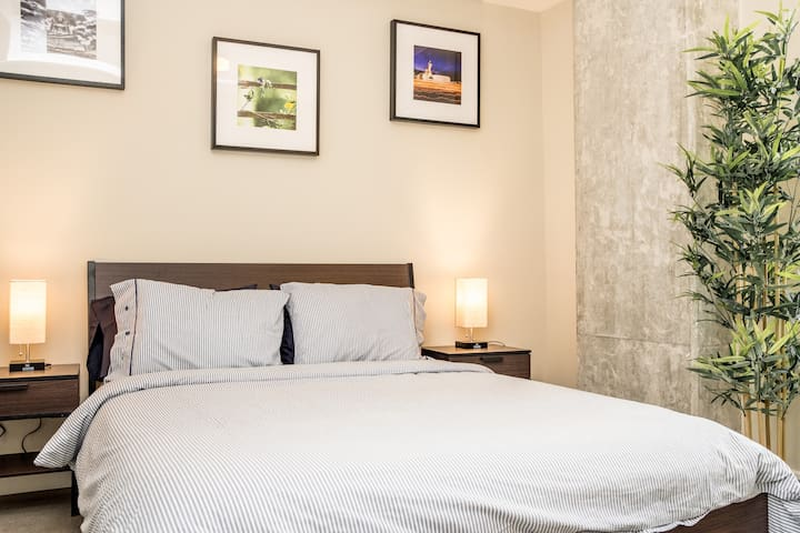"""The master bedroom has a 12"""" memory foam queen size mattress. Pictures I've taken through my travels permeate the entire apartment."""