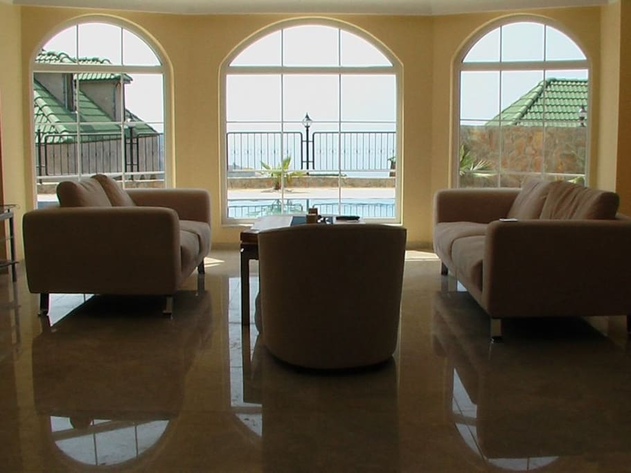 The living room provides a nice view of the pool and garden
