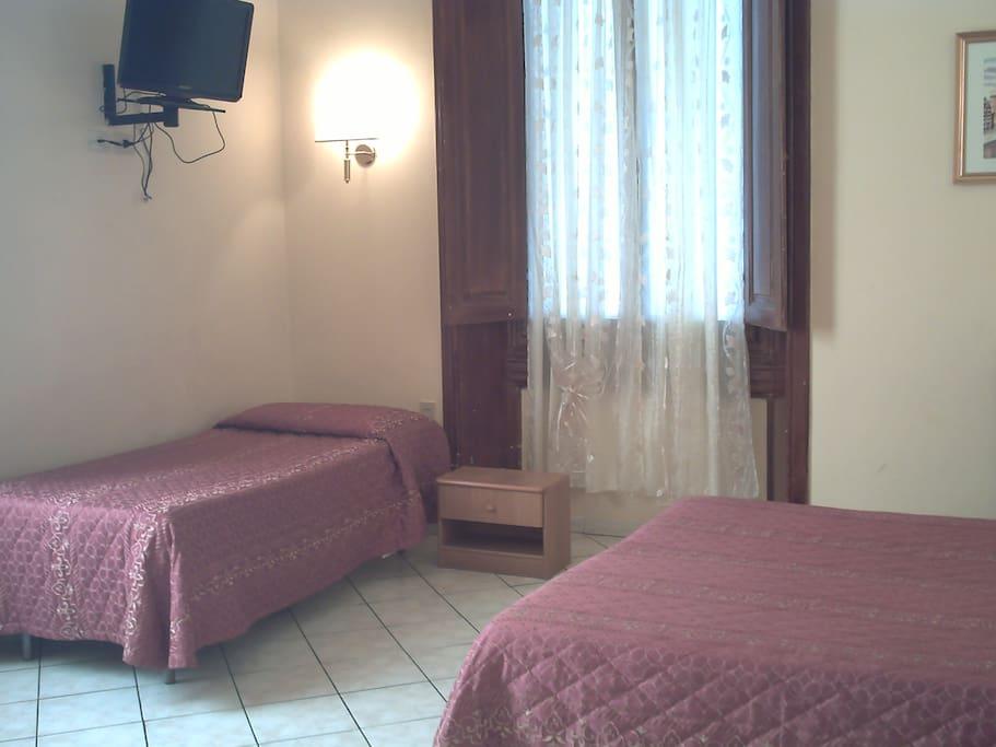 Camera Tripla con bagno esterno