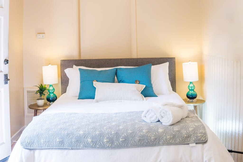 Queen size bed with fresh sheets; hand, face and bath towels