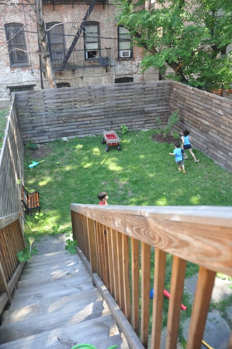 View of the green backyard from the patio.