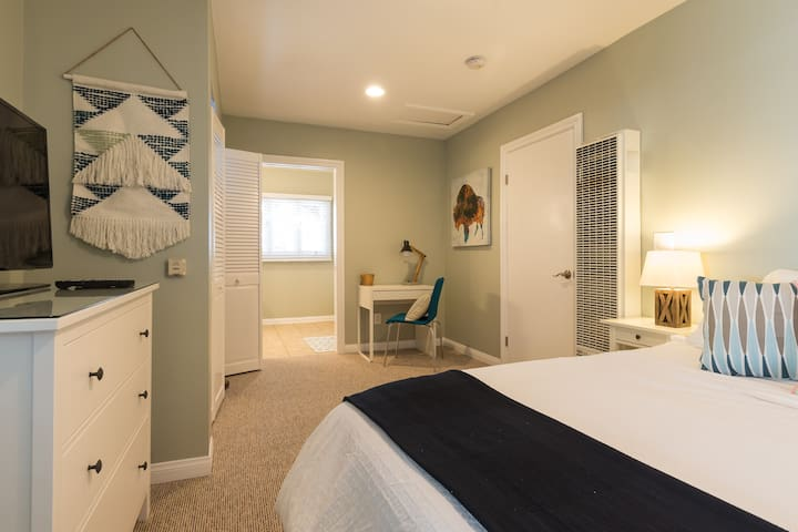 Bedroom with queen bed and flat screen TV