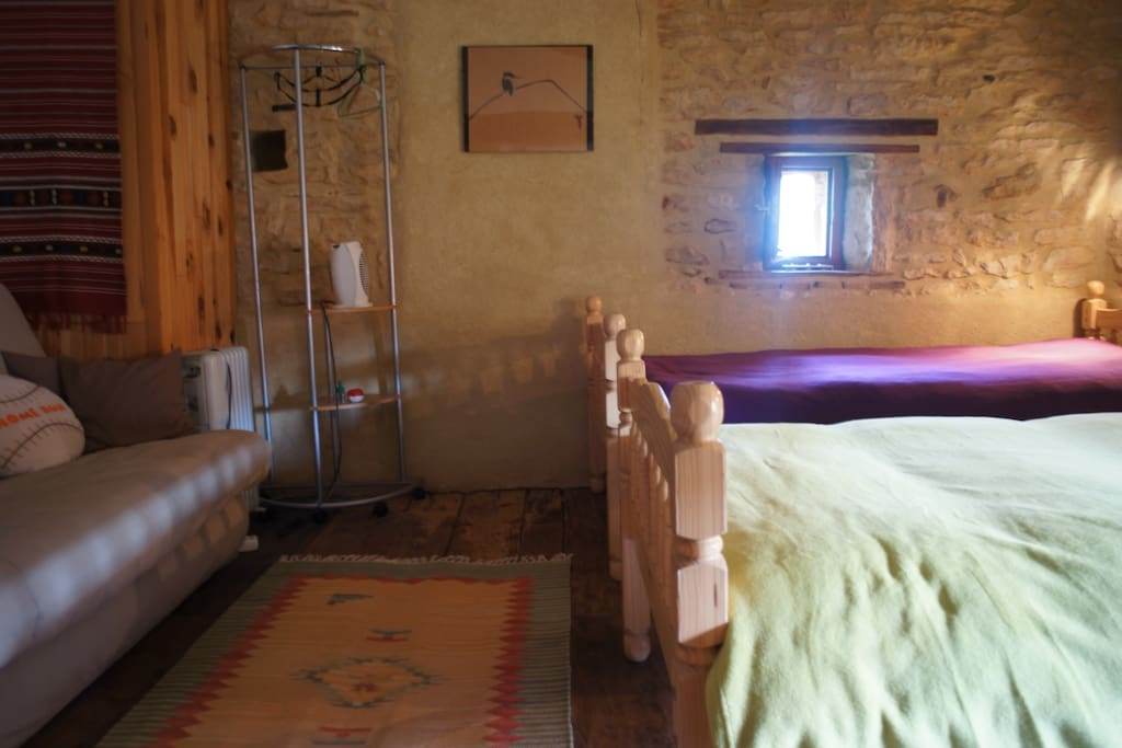 Ensuite at Under The Lime Tree; sofa bed on the left of the photo