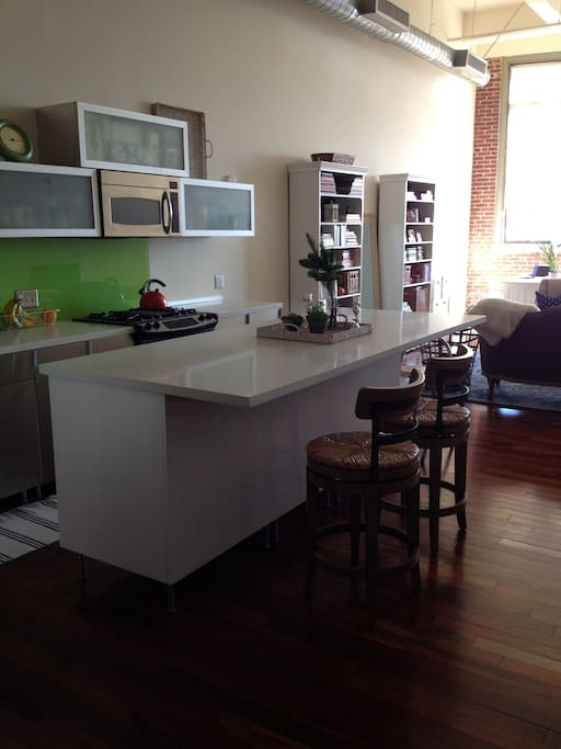 I had this kitchen island custom made for me.  Could not imagine the loft without it.  I use it for everything!  Counter stools (Ballard Designs) swivel, 360 degrees.  3 months old.