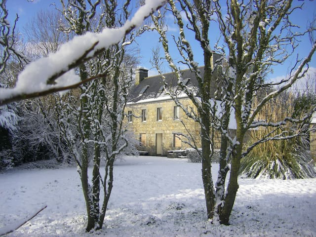 An unusually heavy snowfall - the house is snug in winter.