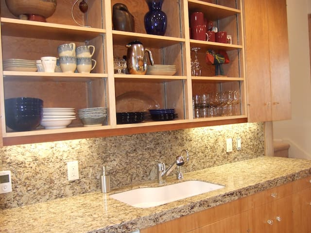 The recently remodeled kitchen features tile, heated floor, gas appliances and all details for home cooked meals.