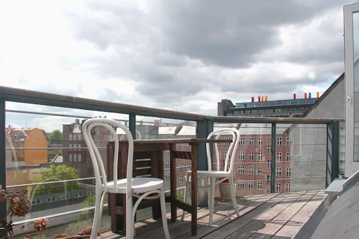 Charming flat with balcony and mezzanine