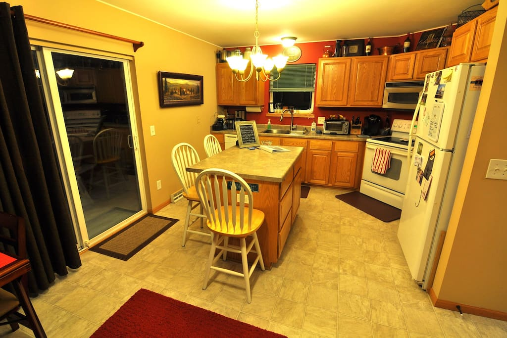 Kitchen has everything you need to cook a meal or a feast!  Extra chairs available!
