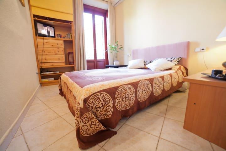 BEDROOM WITH BALCONY; TV; DVD; WIFI
