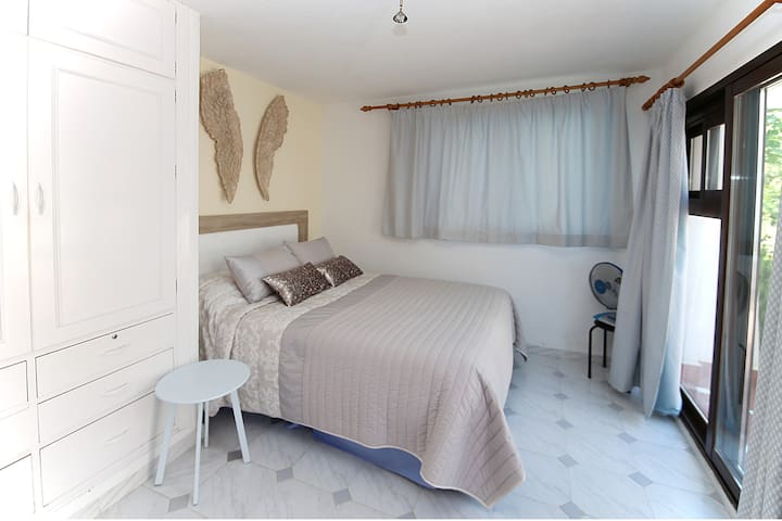 Bedroom area with terrace views - very comfortable double bed
