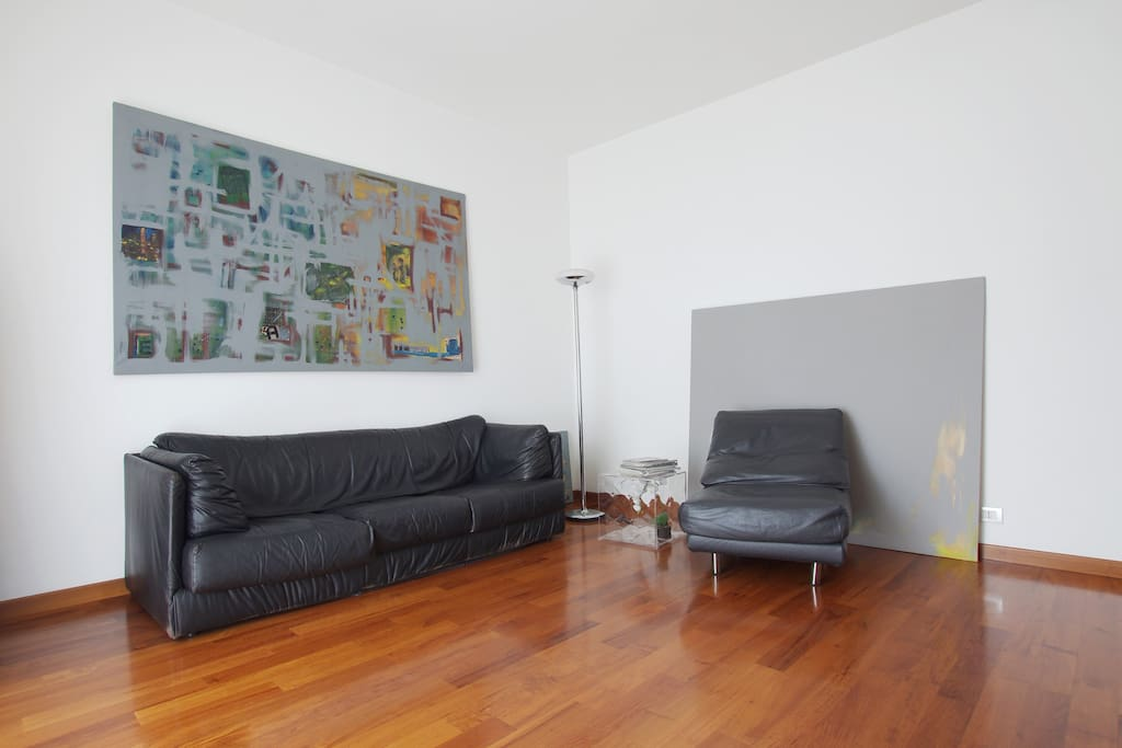 living room with sofa and artworks