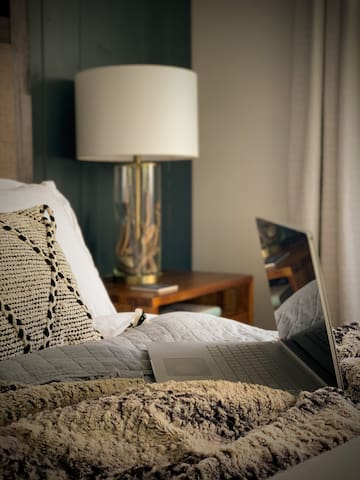 """Work from """"home"""" in the cozy bedroom with plenty of outlets and USB charging ports"""