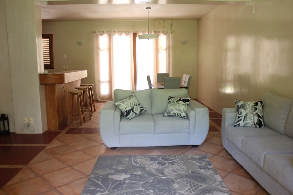 Living room has plenty of comfortable sofas for your entire family as well as full bathroom