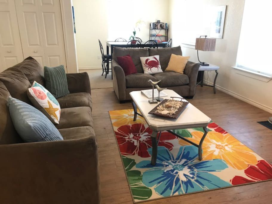 Bright and cheerful living area with 46 in. flat screen TV.