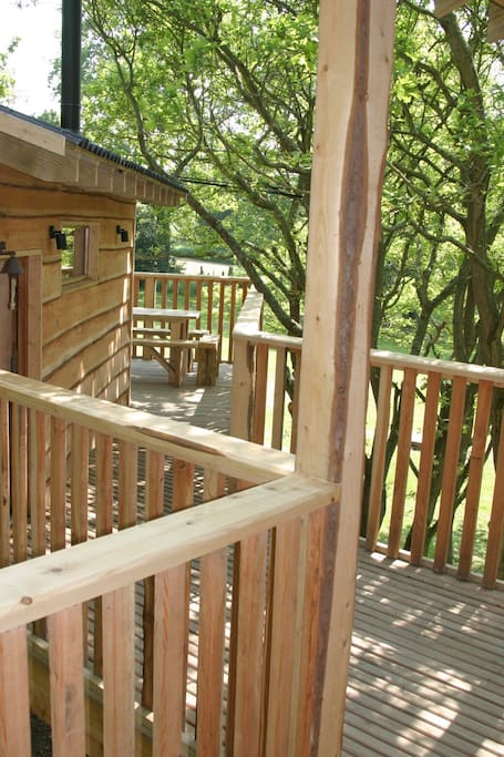 Decking joining the living-house to the sleeping-house