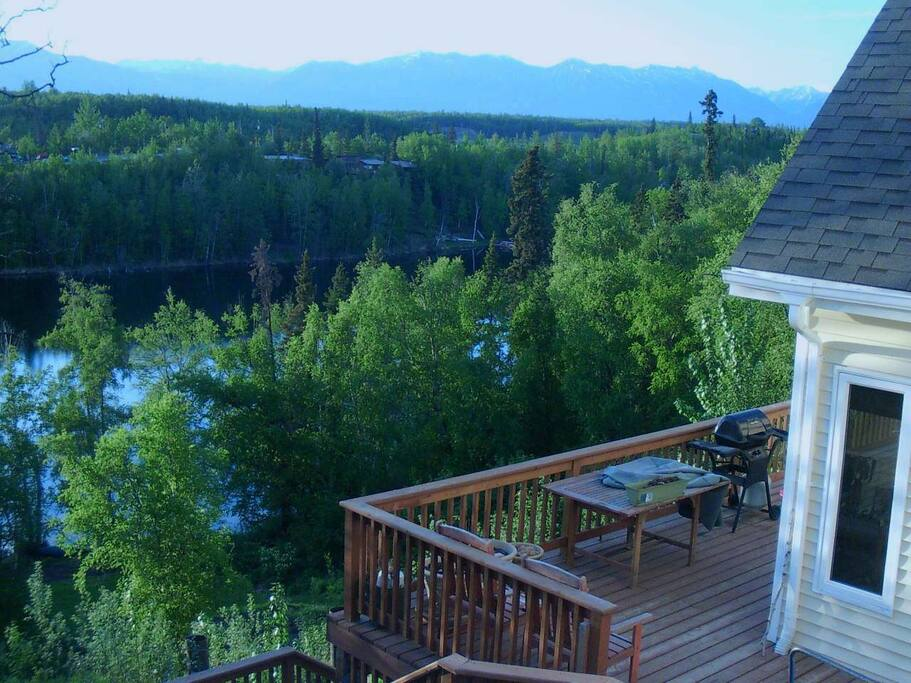 Large wrap around deck over looks the lake and majestic panoramic mountain views.