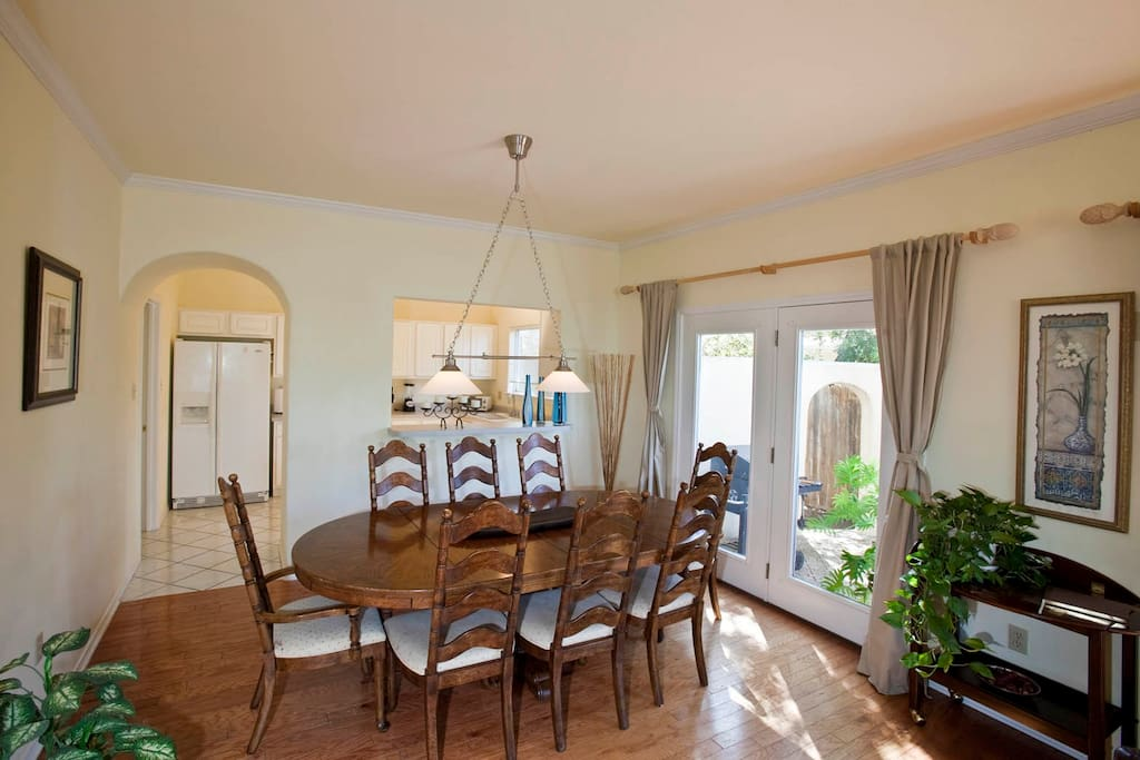 Dining room with patio view. Seats comfortably 8 guests