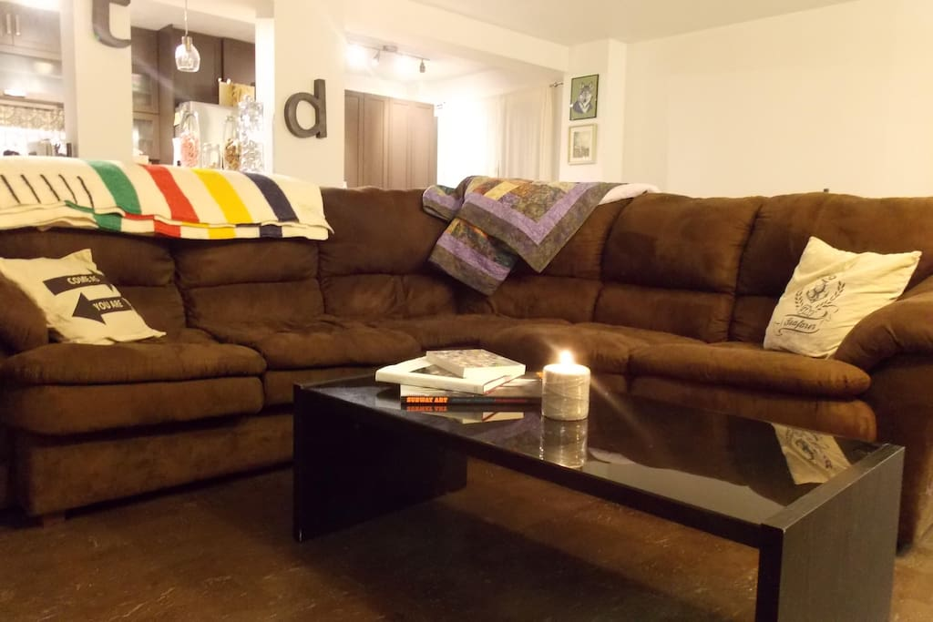 Massive and super comfortable sectional couch. It will envelope you, make sure you're ready to stay and relax!
