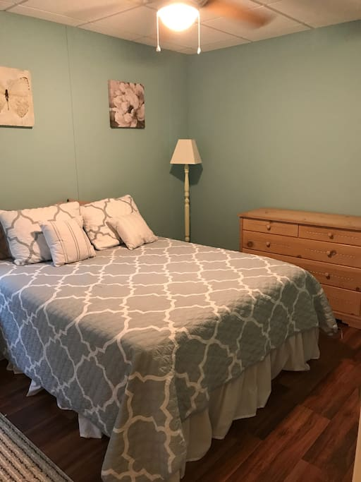 Queen sized bed with memory foam topper