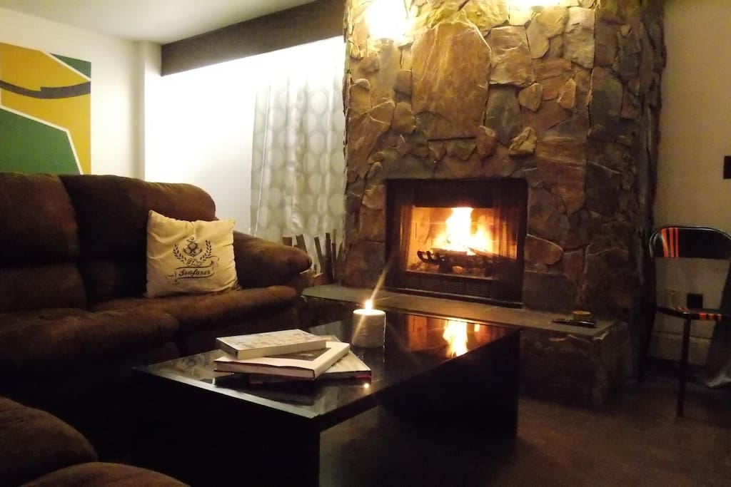 Cozy wood burning fireplace. Perfect for our Canadian winters. There is a small stack of fire wood supplied during the winter months.