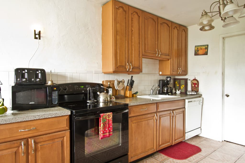 Kitchen in residence with all modern appliances includes microwave, electric coffeemaker, toaster, tea kettle, refrigerator, etc.