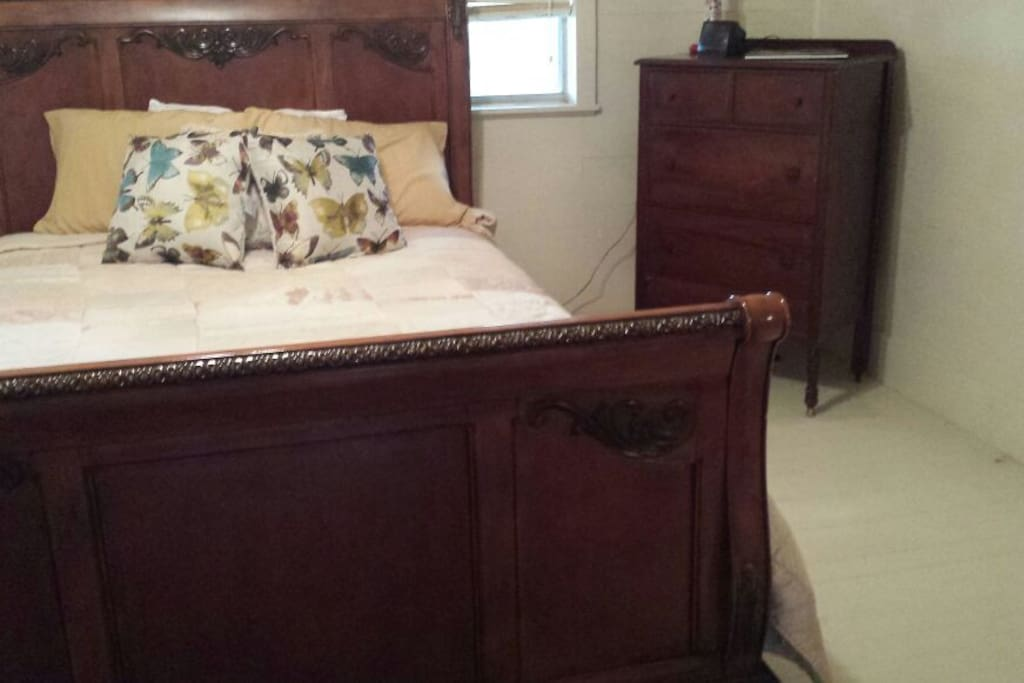 Pretty in Pink bedroom with queen size bed and vanity