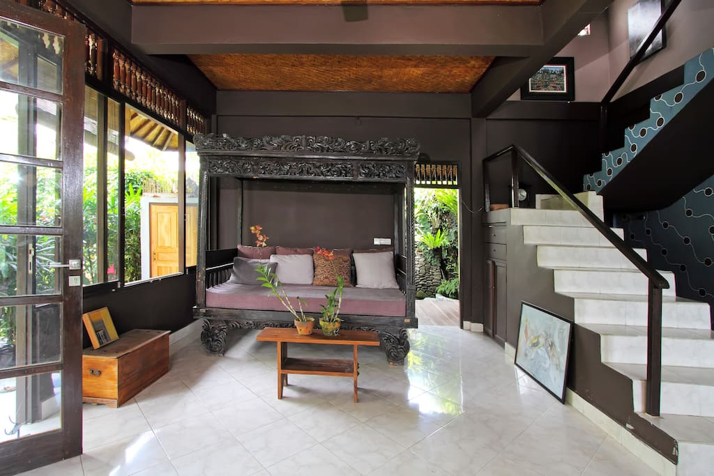 View of daybed and downstairs living.