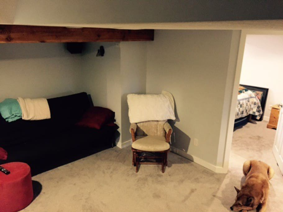 Here is the shared space where you can watch tv and also sleep 2 more on the futon.