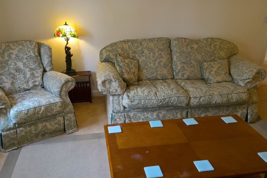 Sitting room with 2 sofas and armchair