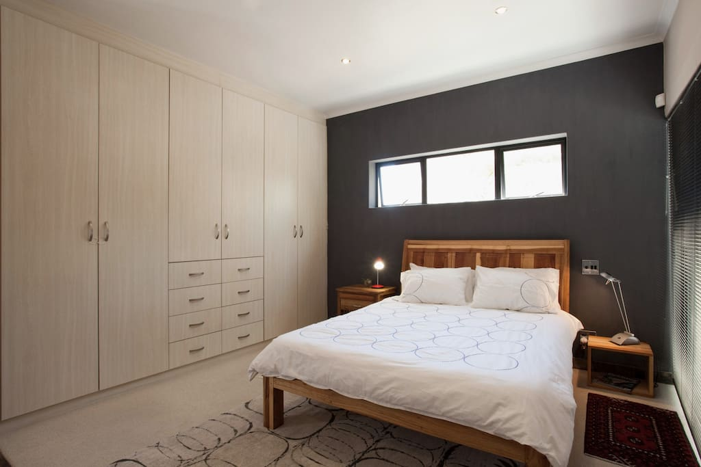 A sunny room with comfortable queen-size bed