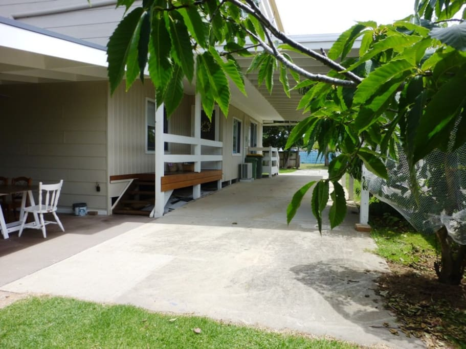 Carport and back entrance/outdoor entertainment area
