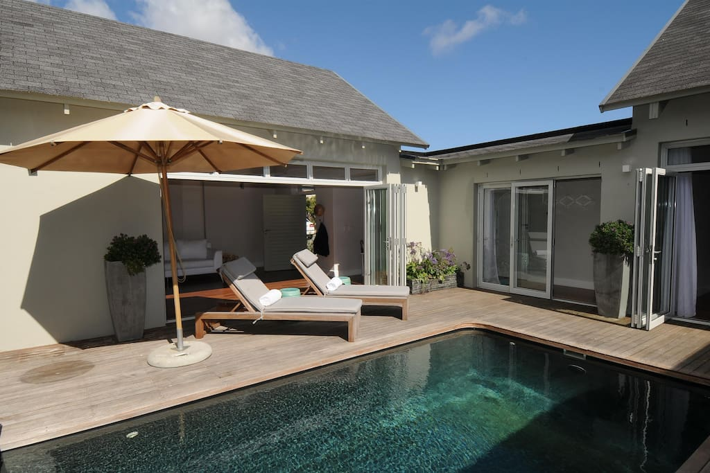 The sheltered, internal pool courtyard is a great place to bask in the sun after a dip.