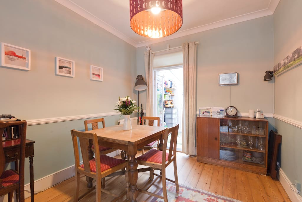 Dining area with square table that extends to fit 6.